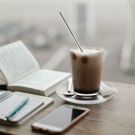 Our reusable straw, minus the plastic, in a cold coffee drink,
